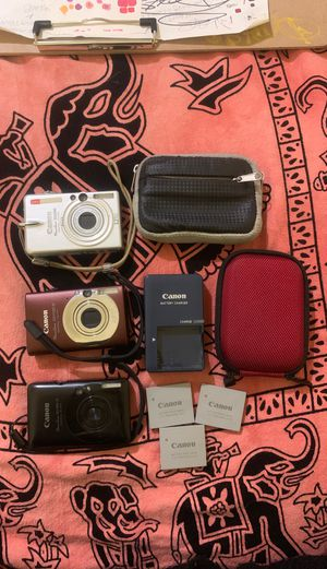Lot of 3 Canon Powershot Digital Elph Cameras! Three batteries, a charger and two camera cases! Everything works great! Asking $30 OBO for Sale in Lemon Grove, CA