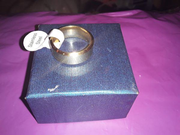 Brand new Size 5 stainless steel ring
