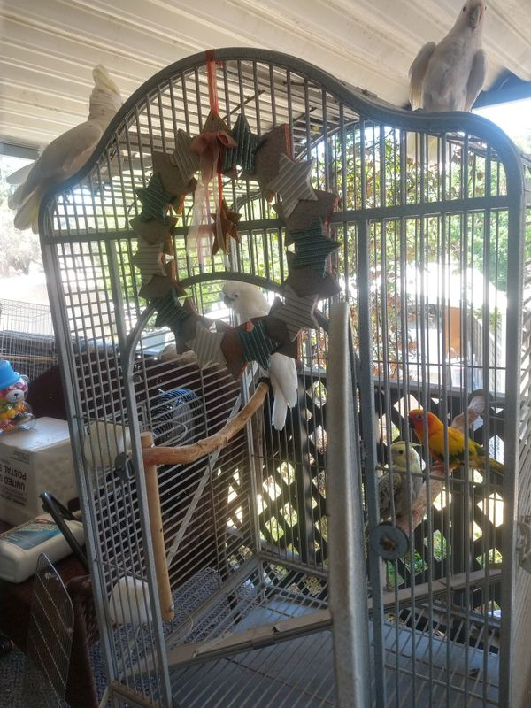 Large white bird cage like new on wheels top opens up