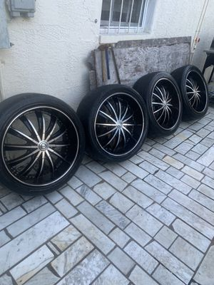 I have 4 wheels 22, 5 holes, they were from a Chevrolet pick up, they need tires for Sale in Tampa, FL