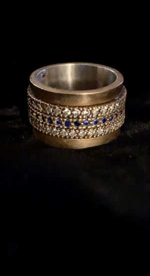 Eternity Band Spinner Blue Sapphire & Crystal Topaz Silver & Bronze Ring Size 6 for Sale in Nashville, TN