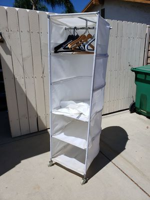 Portable closet. Use in garage or room to hang clothes. Add shelves. On wheels. East to move. $20. Call Bruce {contact info removed} for Sale in La Verne, CA