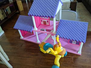 Doll house and baby giraffe bike for Sale in Surprise, AZ