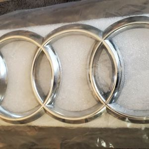 Audi front grille logo new in package for Sale in West Palm Beach, FL