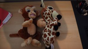 Stuffed animal giraffe and money from Disney for Sale in Upland, CA
