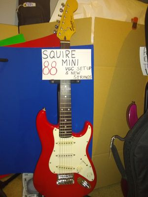 "Red Squier ""mini"" by Fender very good condition has a few scuff marks on the front below the bridge. for Sale in Spring, TX"