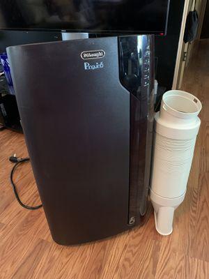 DeLonghi 4-in-1 Portable Air Conditioner, Dehumidifier, Heat Pump, and Fan with Remote - 14000 BTU (ASHRAE) for Sale in Union Park, FL