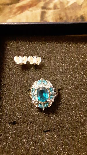 A pair of butterfly earrings costume and a costume ring with blue gems for Sale in Woodstock, VA