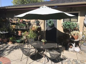 WROUGHT IRON PATIO FURNITURE TABLE WITH 4 CHAIRS. Cushions and umbrella not included for Sale in Stockton, CA