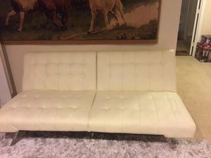 Foldable white leather couch, small hole in the couch, everything else is in good condition for Sale in Sully Station, VA