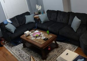 Ashley Furniture and coffee table in the middle has marble 1 year old for Sale in Philadelphia, PA