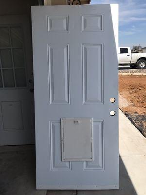 Exterior door with doggie door for Sale in San Angelo, TX