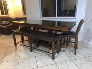 Very tall dining table with 2 benches and 2 stools for Sale in Miami, FL