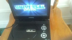 Audiovox portable dvd player free dvds superman backpack for back to school when you purchase for Sale in Chicago, IL