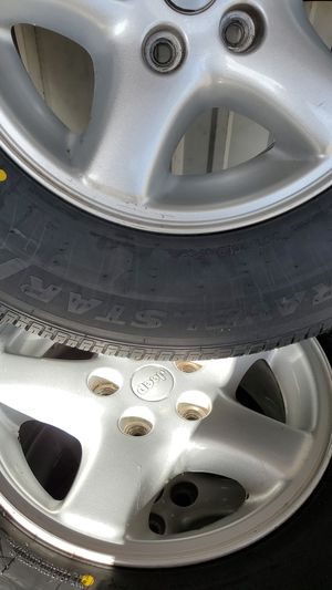 Jeep rim's with brand new tires set of 4 plus sapre included for Sale in Madera, CA