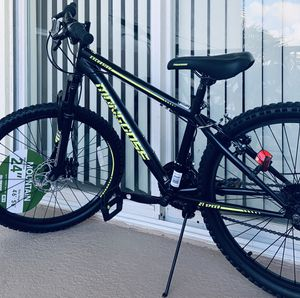 Mongoose Excursion mountain bike, 24-inch wheel, 21 speeds, black/Green for Sale in Doral, FL
