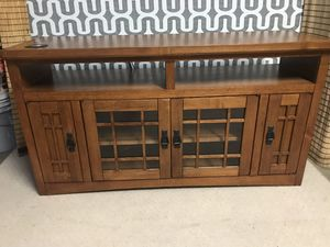 "Tv console with two cabinets and one shelf heavy wood sturdy no damage 52""x28""x14"" for Sale in Clermont, FL"