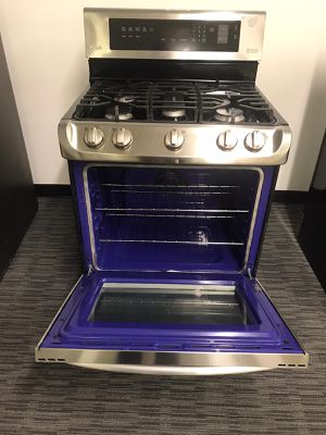 LG Stainless Steel Gas Stove With Warranty Scraches Dent No Credit Needed Just $79 The Down payment Cash price $899 for Sale in Garland, TX