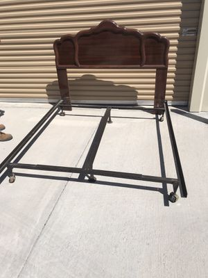 CHERRY WOOD QUEEN HEADBOARD AND METAL BED FRAME for Sale in El Paso, TX