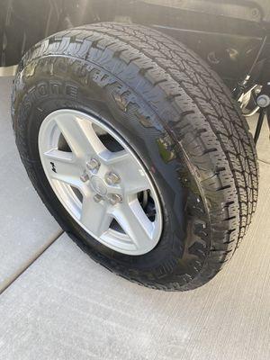 new 17 Inch Jeep Wheels with Bridgestone tires for Sale in Layton, UT