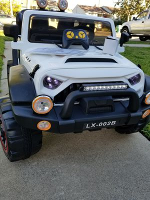 BRAND NEW WHITE 2 SEATER 12Volt Jeep Toy Power wheels for kids with REMOTE CONTROL for Sale in Lakewood, CA