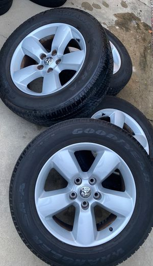 Dodge RAM 1500 OEM wheels with 275/60/20 Goodyear Wrangler SR-A Tires for Sale in Claremont, CA