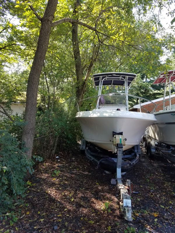 Hello i am selling 21 feet boat center comsole ready to fishing with a 115hp 2013 evenrude in good conditions the price is $9000 only serious buyers