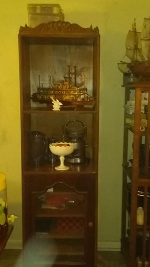Cabinet all wood. 2 Shelves at top. 5, Shelves on Bottom With Glass enclosure..Asking $75,00. for Sale in North Little Rock, AR