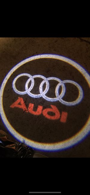 Audi car door projector lights auto on and off aaa batteries for Sale in Paramount, CA
