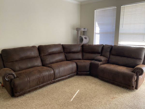 Reclinable brown couch with charging ports