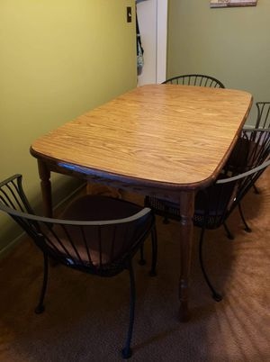 Oak kitchen table set w/4 heavy wrought iron chairs excellent condition table is 57×36 w/1 leaf in for Sale in Parma, OH