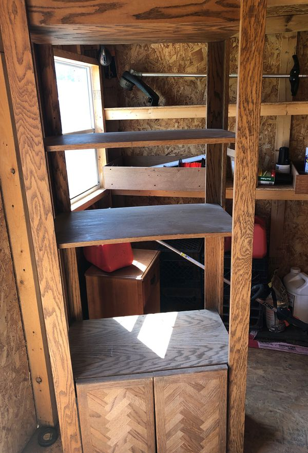 Shelves for family room with storage Underneath