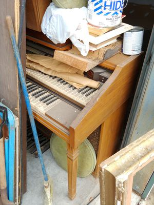 Free electric organ and antique furniture with some termite damage, curved glass showcase, early 19th century secretary, chairs , chest for Sale in Tampa, FL