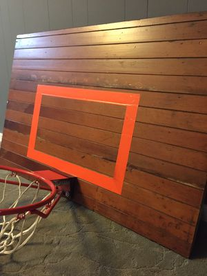 Awesome reclaimed 125 year old Fir basketball backboard with modern break-away hoop. for Sale in Portland, OR