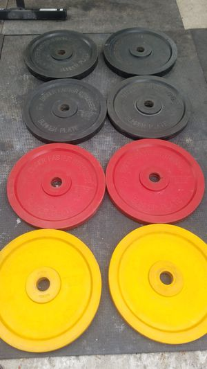 EXERCISE FITNESS EXCELLENT CONDITION BIGGER FASTER STRONGER COLOR OLYMPIC BUMPER PLATES for Sale in Long Beach, CA