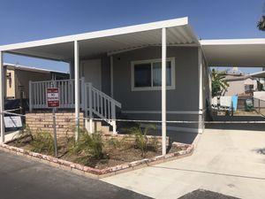 Bella mobile home remodela completamente 2/2 paga solamente 1,450 por tu casas spc para 3 carros sólo llámame para más información for Sale in Anaheim, CA