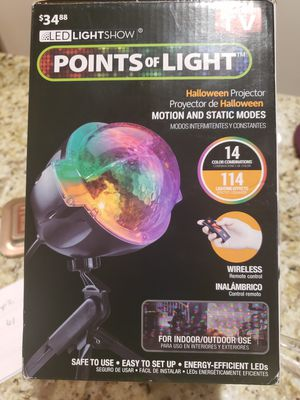 New Holloween Projector with wireless remote for Sale in Bloomington, IL