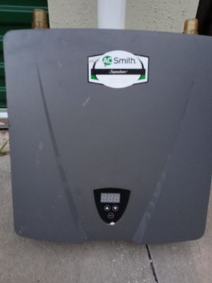 Ao Smith four port electric tankless hot water heater for Sale in Oklahoma City, OK
