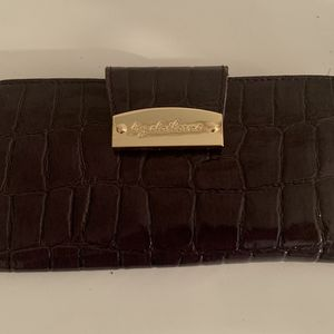 Liz Claiborne wallet, 100% purpolyvinyl material, beige polyester inside. 15 credit card pockets, 2 pockets with zipper one inside, one outside, a for Sale in Centreville, VA