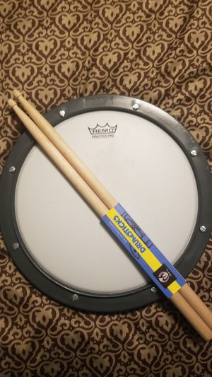 REMO drum practice pad tunable with Drumsticks for Sale in Everett, WA