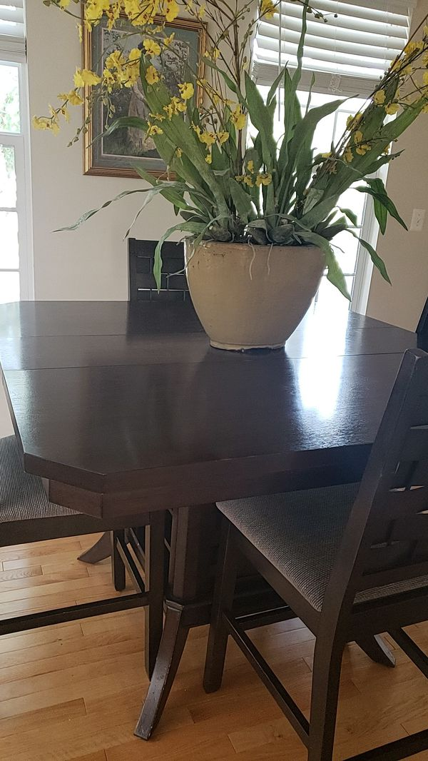 Dining table and 4 chairs with wine rack