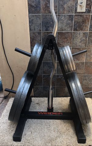 BRAND NEW Weider Barbell, weight plates, and storage Rack for Sale in San Diego, CA