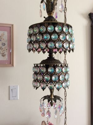 Aurora Borealis by Swarovski two tier hanging fixture. Over 100 shimmering crystals and 12 foot brass chain. for Sale in Plainview, NY