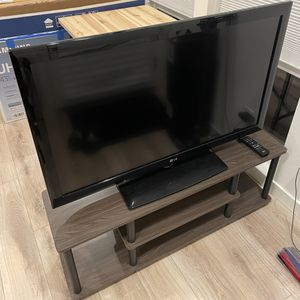 LG 42 inch Full HD 1080p LCD TV + TV Stand for Sale in Seattle, WA
