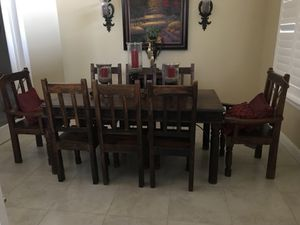 Dining table, 2 arm chairs, 8 side chairs, wine cabinet, large hutch for Sale in Hanford, CA