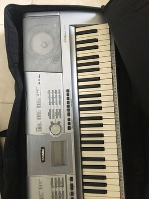 yamaha portable grand dgx-230 + travel bag for Sale in Hollywood, FL