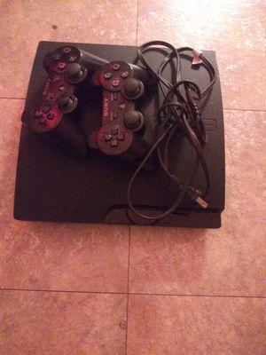 Ps3 with 2 wireless controllers and games for Sale in Greensburg, PA