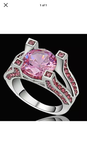 Modern engagement ring pink sapphires channel set on triple split bands and claw with round center sapphire on sterling silver band sz7 for Sale in Northfield, OH