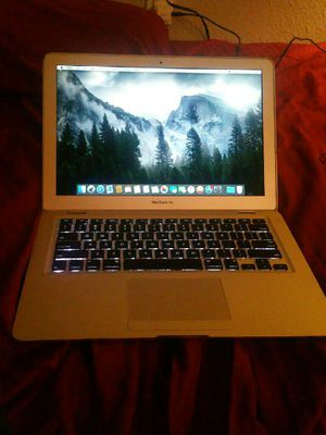 Macbook Air 13 inch 2009 works great comes with charger screen is a little wobbly with some dents no issues message me! for Sale in Irvine, CA