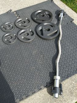Olympic Curl Bar And Weights New for Sale in Puyallup,  WA